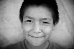MANY CHILDREN at the camps hung out and allowed us to take their portraits. (Photo by Jesse Green)